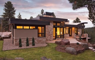 Custom built green home with stone and large windows