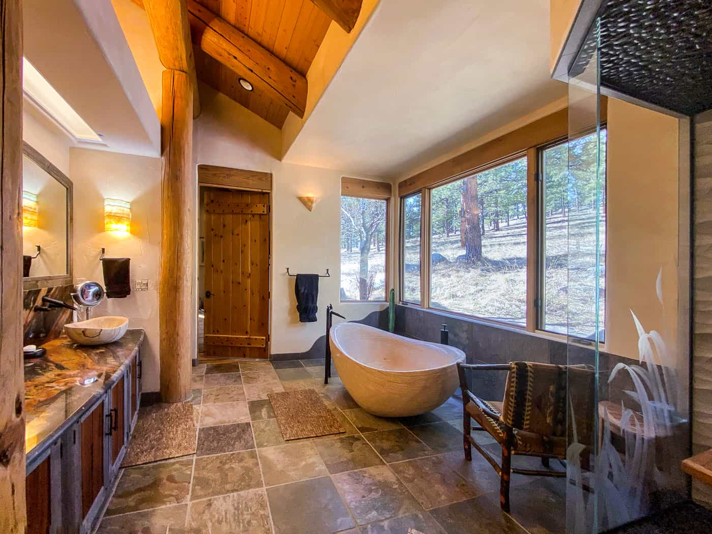 Rustic bathroom remodel with soaking tub and big windows