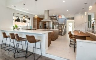 Contemporary Culinary Home - remodeled kitchen with white quartz countertops and ikea countertops